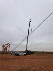 140-SS-tower-being-raised-at-oil-well-site-Sidney-MT-225x300